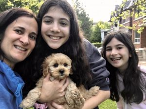 Family with puppy from Perfect Puppies